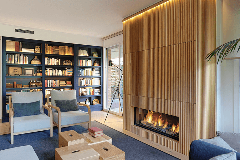 Apartamento Les Tres Torres chimenea| Pablo Peyra Studio